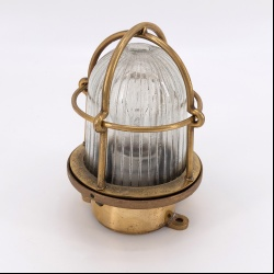 Small brass lights with glass and brass cage, table or wall light